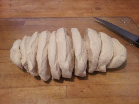 Stage 1. Roll your dough to a sausage shape and cut into 12 equal pieces