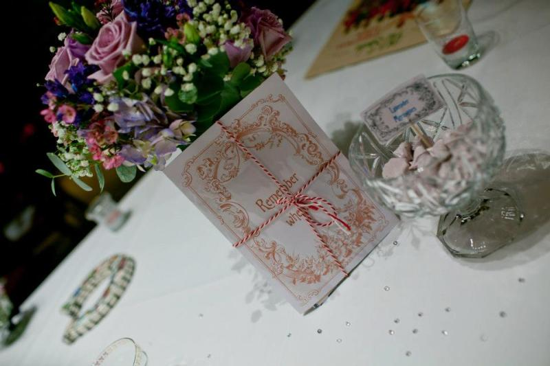 The table favours petite Italian Lavender Merinuges in vintage glass wear with nostalgic photos for our guests