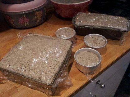 The cling film covered and proving loaves
