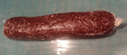 a cling film wrapped chocolate sausage