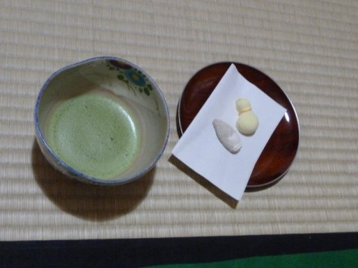 Matcha Green Tea and tiny sugar sweets to help wash down the frothy bitter tea