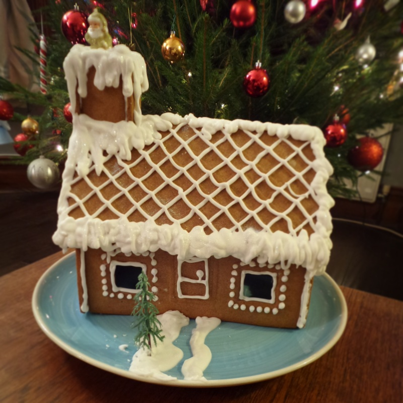 Gingerbread house smothered in royal icing and complete with santa stuck up the chimney