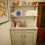 After: The upcycled chalk painted kitchen dresser now with [roper shelves not just a plate rack to house my ever growing collection of cook books