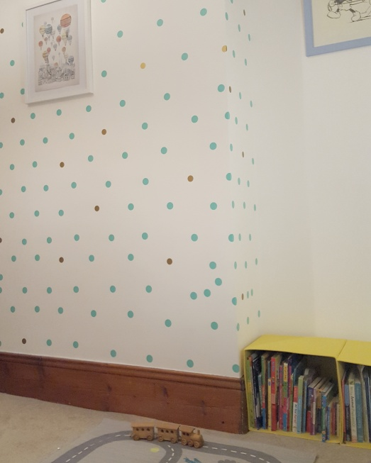 Image of duck egg blue and gold polka dots on bedroom wall